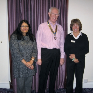 New Member Anu Brown welcomed by President Barry James and Susan Lambreton -Towell
