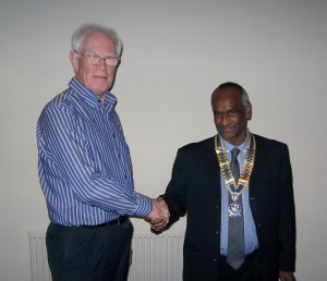 Retiring President Barry James inducts New President Tyrone Price into office.
