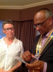 President Tyroe invests Shirley Jones as a new Rotarian.