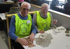 Rtn.Barry & Rtn Stan begin the counting of donations.