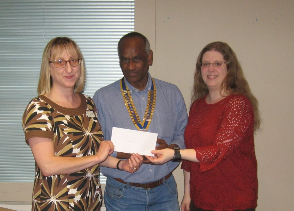 Helen Schielke recieves £600 Cheque from President Ty Price supported by Friend of Rotary Jenny Hesketh.